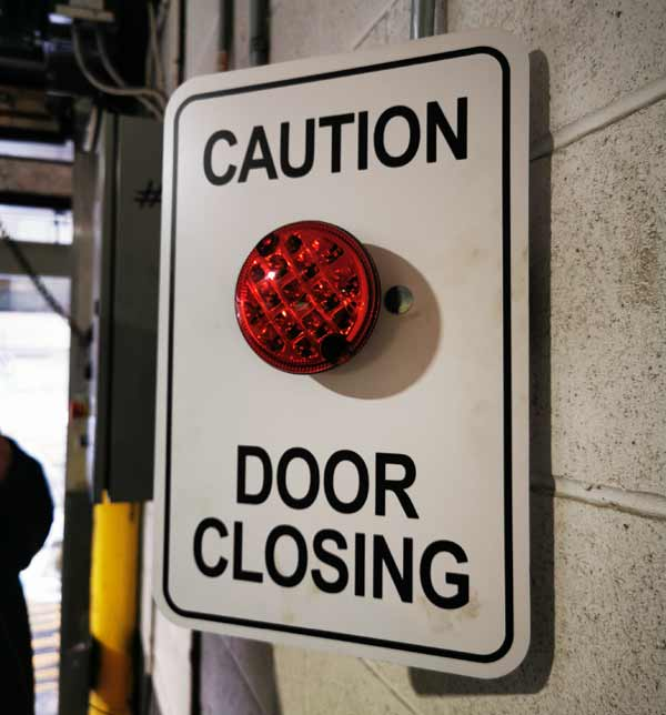Caution Closing Door Sign